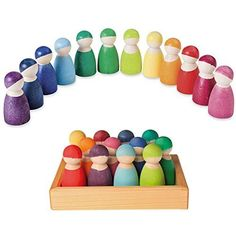 Grimm's Set of 12 Rainbow Friends Peg Dolls - Wooden Pretend Play People Figures with Storage Tray Grimm's Spiel and Holz Design http://www.amazon.com/dp/B00CRVKBMC/ref=cm_sw_r_pi_dp_lJGswb11CQ575