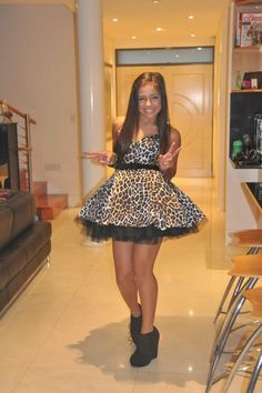 this dress is super cutesie! i'd wear it all the time. it'd be even better if it were zebra print! :)