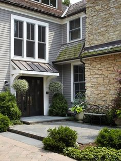 Attractive combination of materials, changes in elevation to create a landing at the entry door.