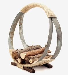 Wine Barrel Hoop Firewood Rack   Stack all of your wood for the fire in this rustic rack, craft...   Fireplace Tools