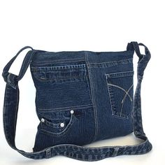 I turned a dark blue denim pant to this beautiful and functional cross body bag. Back and front sides are different.You will find two open pockets and one zipped pocket on the front side,and another open pocket on the back side. It is fully lined with a cotton fabric,and has 2 inside