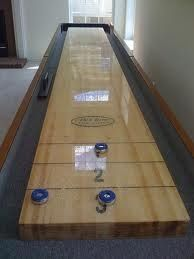 DIY Shuffle Board Table - might have to get Himself to make one of these for the basement in our dream house!! LOL! ;)