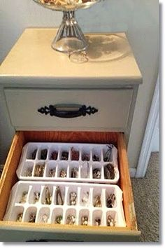 Ice cube trays used to organize jewelry