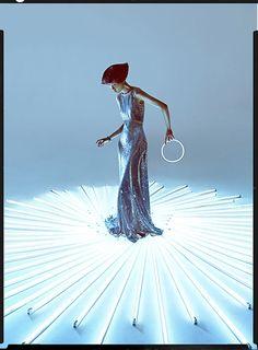 Charles Guo photographs model Wang Xiao wearing Tron inspired futuristic fashion.