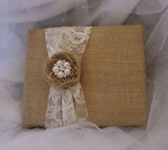 guest book with pearl and burlap. Kahla- I can make this and add in hot pink. It would be super cheap to make.