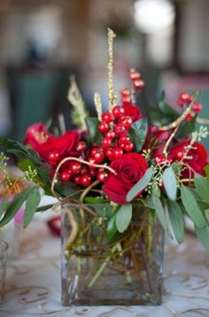 Centerpieces ~ A classic centerpiece filled with roses, berries, and greenery ~ Winter Wedding Christmas Wedding Centerpieces, Christmas Wedding Flowers, Winter Centerpieces, Winter Wedding Decorations, Centerpiece Decorations, Winter Weddings, Christmas Arrangements, Centrepieces, Winter Wonderland Wedding