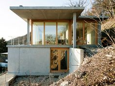 Gian Salis' House on a Slope steps down a hillside in the Rhine Valley  http://www.dezeen.com/2015/02/20/concrete-house-on-a-slope-terraces-hillside-rhine-valley-germany-gian-salis/