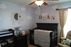 Elephant themed boys nursery. I love the sky look with the clouds and the baby blue