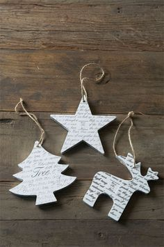 make ornaments like this by cutting shapes with Cuttlebug and glueing together with book print on the outside.  antique the page with stain- done!
