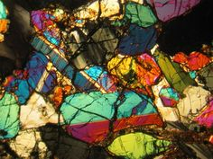 NWA 998 Martian meteorite thin section viewed in cross-polarized light. Genuine Lunar and Martian meteorites available at Galactic Stone and Ironworks. Crystals And Gemstones, Stones And Crystals, Meteor Rocks, Right Brain, Mineralogy, The Martian, Pretty Pictures, Geology, At Least