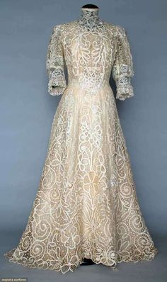 Trained Cream Lace Tea Gown - One Piece, Handmade Battenburg Lace And Machine Made Valenciennes Lace Inserts, High Collar, Fuffled Lace Elbow Length Sleeves   c.1906  -  Augusta Auctions