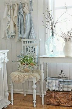 love this chair and the soft blue and cream around it