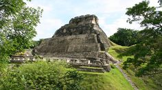 """Once a ceremonial center, Xunantunich means """"stone woman,"""" referring to the ghost of a woman whom several people claim they've seen lurking around the popular tourist destination since 1892. If ghost hunting isn't your thing, then we suggest climbing to the top of the ridge of this amazing Mayan archeology site for a great view of the border shared with Guatemala."""