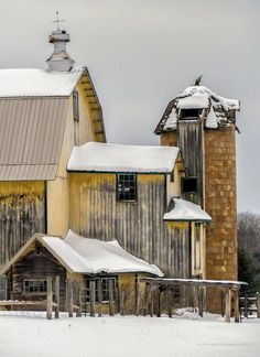 Yellow barn in the snow.
