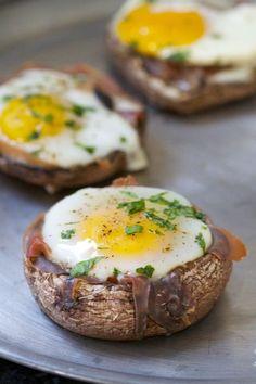 Paleo Baked Eggs using farm fresh eggs, portobello mushroom caps, prosciutto slices, black pepper, fresh parsley or thyme, and olive oil.