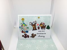 Lawn fawn cheery Christmas also lawn fawn large stitched rectangle and stitched hillside border were used to create this card. The small tree on the right is a stamp and die from mama elephant reindeer games. I found the idea for this card from Pinterest, from a card created by Kim Hamilton. Created and uploaded by Linzi Atherton.