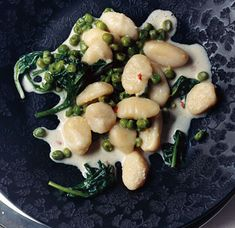 Lemon Gnocchi with Spinach and Peas by epicurious: Easy and delicious! The zing of fresh lemon enhances both the peas' sweetness and the natural flavor of the spinach. The whole quick, creamy dish is bolstered by soft pillows of potato gnocchi.  #Gnocchi #Spinach #Peas #Lemon