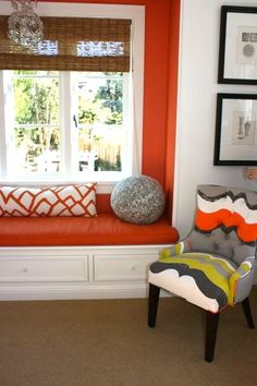 orange and gray room and corner chair