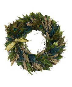 Add all the beauty of fresh botanicals to décor without the work of watering! Designed with natural leaves, cedar, peacock feathers and more, this lovely wreath is an eye-catching seasonal accent.
