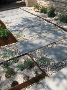 Love paver walk way within the gravel (one of our back yard projects from the patio to the gate)