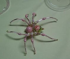 DIY Beaded Spider. Gorgeous examples like one with pearl beads at http://www.shawkl.com/2011/09/dont-be-afraid.html @Brittany Rose