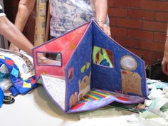 """Cloth """"quiet book"""" style doll house."""