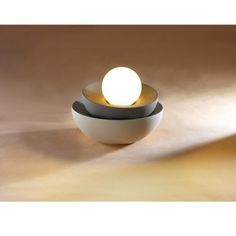 Moon Lamp -  This lamp is born around the shape of a sphere and its sections, that, when stacked can form a solid complex. The two bases, makes the lamp more graphic. And the main source of light it's exposed on the top.