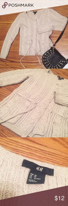 """h&m ivory knit button sweater h&m ivory knit button sweater with waist string. 🔹Goes well with jeans, skirts🔹Great for layering🔹Size XS 🔹measurements:  15"""" shoulder, 21"""" sleeves, 32"""" bust, 19"""" from shoulder to bottom. 🔹Excellent condition. H&M Sweaters Cardigans"""