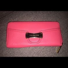 Michael Kors Continental Wallet NWOT. Perfect condition. Pink/coral in color with gold hardware. Matching purse listed. Michael Kors Bags Wallets