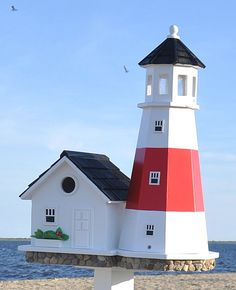 This lighthouse birdhouse is a spot-on replica of the famous Montauk Point Light located at the easternmost point of Long Island, New York. Construction of the lighthouse was authorized by none other than President George Washington and bears the distinct Bird House Plans, Bird House Kits, Montauk Point, Birdhouse Designs, Unique Birdhouses, Birdhouse Ideas, Decorative Bird Houses, Point Light, Bird Aviary
