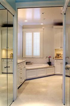 walk through closet with mirrored doors, Perfect! plus it's in the bathroom, which makes way more sense.