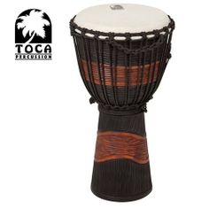 Toca Street Series Djembe (Small Black) by Toca. $44.99. Made with traditional materials for authentic sound. Toca's Street Series djembe makes a wonderful addition for any drummer who's looking to expand their musical creativity. This budget friendly djembe is made of mahogany wood and is equipped with a hand selected head. Each drum is hand carved and beautifully painted, making each of them unique in its own way.