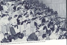Fans cheer during a swim meet on campus vs. Oregon State 1947. From the 1947 Oregana (University of Oregon yearbook). www.CampusAttic.com