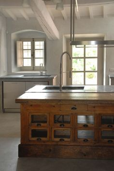 """Great """"scientific"""" vibe in this laboratory style kitchen."""