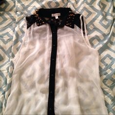 Must have top Classic sheer sleeveless top, with spoke detail, and lace on back, it's a combination of good girl, and bad girl, perfect with some tights Roomates Tops