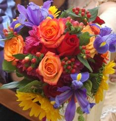 Bright spicy colors work beautifully for an August wedding. Think fuchsia paprika goldenrod and accents of brown and white. The colors we associate with a Mexican fiesta are fantastic