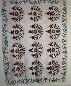 Rose and Buds - aka Pomegranate Wreath or Prairie Flower.  Quilt was made by Eleanor Euphemia Young, ca. 1840.  73 x 111 inches.