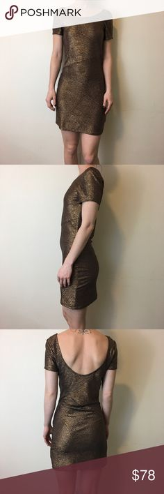 FREE PEOPLE Metallic Foil Bronze Bodycon Dress Free People Dress that is short sleeve and has a Bodycon fit- short and is not lined.  Is not Sheer and is thin fabric and is great for hot places! Worn once and is in great condition no flaws. Bronze like and looks like Foil! Free People Dresses Mini