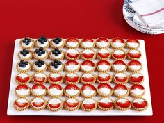 Fruit-Tart Flag Fill premade miniature tart shells or phyllo cups with sweet mascarpone cream (recipe below), then arrange on a tray and top with blueberries and halved strawberry slices to create stars and stripes. Mascarpone Cream: Beat an 8-ounce container of mascarpone cheese and 3 tablespoons confectioners' sugar with a mixer until smooth. Gently fold in 1/2 cup freshly whipped cream