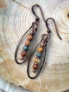 These earrings are earthy, rustic and very light-weight. Made with neutral red…