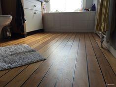 Een teak vloer met scheepsdek motief, zeer geschikt voor in de ...