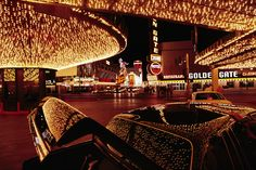 A Las Vegas hotel's neon lights are reflected on a parked car, December 1992. Photograph by Chris Johns, National Geographic