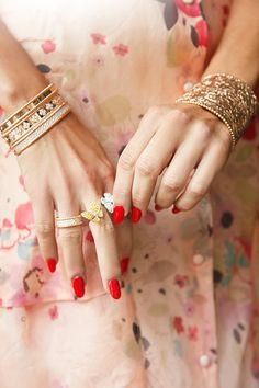 red nails + serious jewels