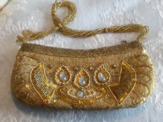 Vintage Gold beaded clutch with large crystals on both sides. Even handle is beaded. Beaded Clutch, Large Crystals, Vintage Handbags, Gold Beads, Evening Bags, Clutch Bag, How To Wear, Beautiful, Fashion