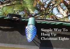 Binder clips offer a handy way to hang lights on the outside of your house. The color blends into the dark roof and the clip design makes it super easy to hang and then take down at the end of the season.