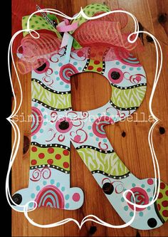 Check out this item in my Etsy shop https://www.etsy.com/listing/173869252/colorful-polka-dot-flowers-wooden-letter