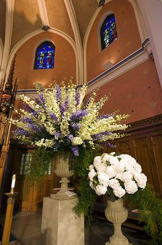 Spectacula - Urns of white hydrangeas, asparagus ferns and white and purple delphiniums decorate the church. Alter Flowers, Church Flowers, Purple Flowers, Large Floral Arrangements, Church Flower Arrangements, Formal Wedding, Dream Wedding, Wedding Church, Wedding Ideas