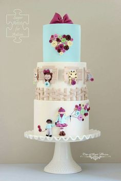Cutesy cake for autism awareness Gorgeous Cakes, Pretty Cakes, Amazing Cakes, Fondant Cakes, Cupcake Cakes, Cupcakes, Africa Cake, Cake Designs For Kids, Girly Cakes