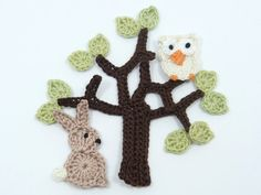 13 crochet appliques including 1 chocolate brown tree, 10 tiny pale green spring leaves, 1 beige rabbit and 1 cream owl make up this cute