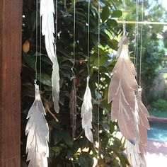 A coffee can becomes a feather wind chime using the Dremel Micro More
